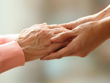 Younger and older hands holding, Alzheimer's Test Blog