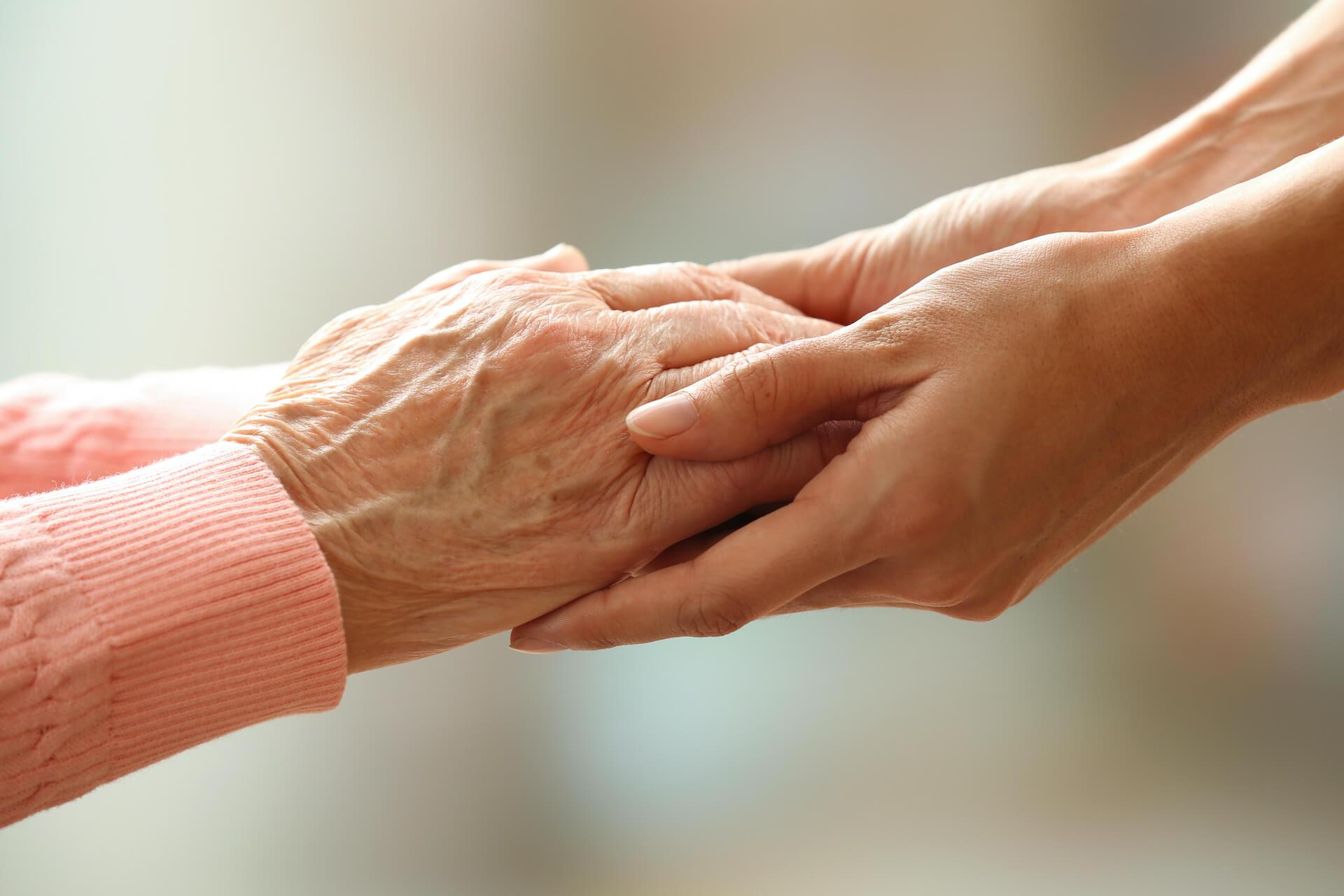 Younger and older hands holding, Alzheimer's Test Blog