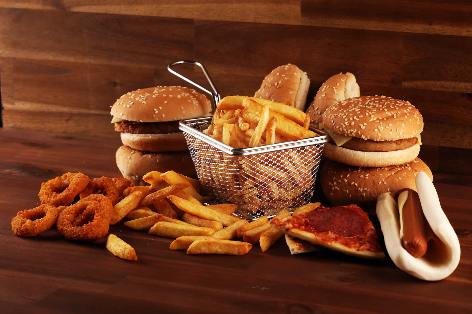 junk food; burgers, onion rings, french fries, pizza