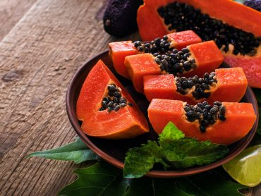 a bowl with a colorful papaya