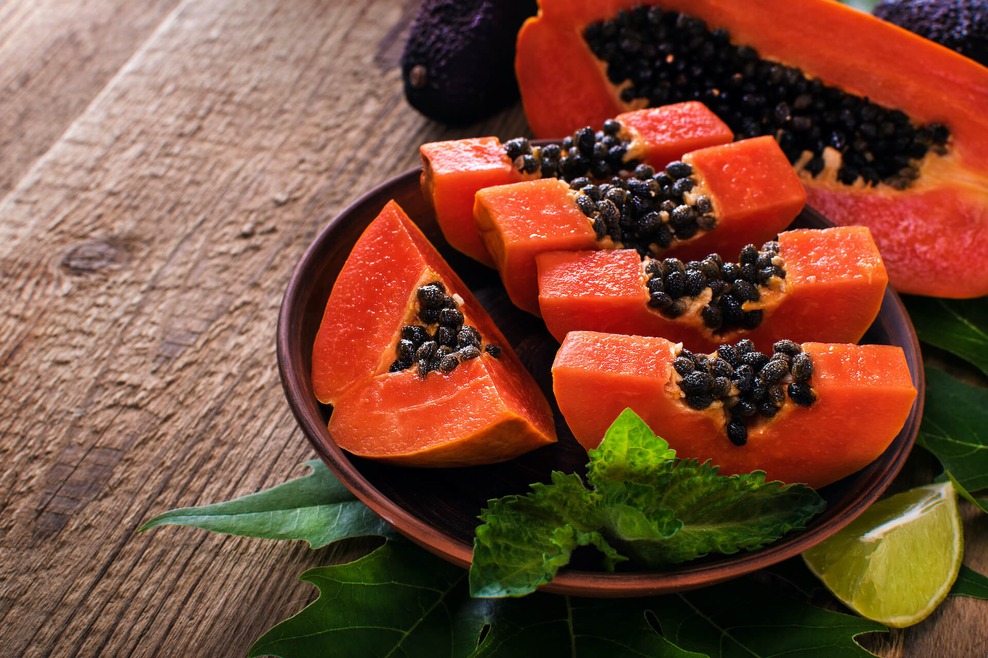 a bowl with a colorful papaya
