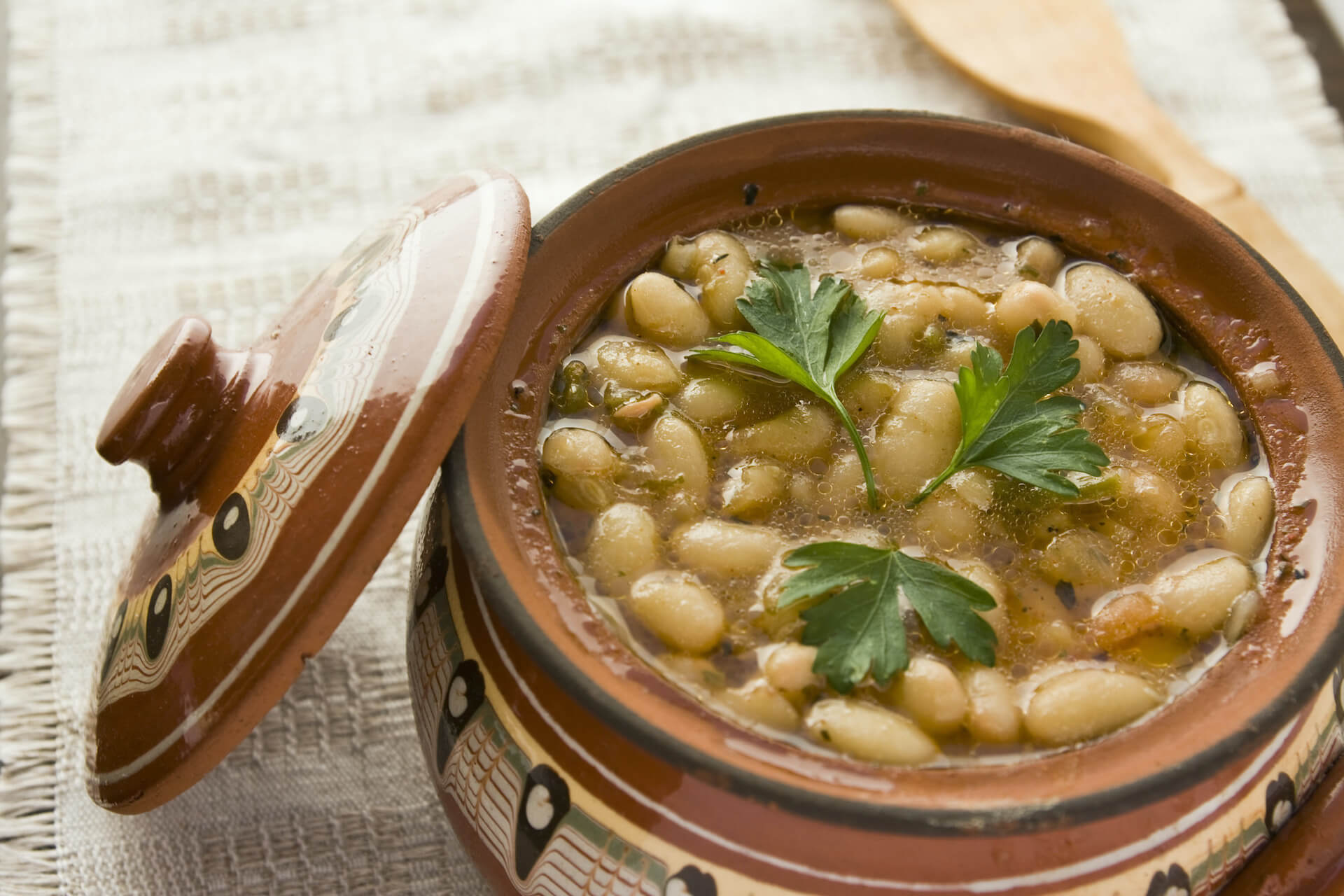 beans with cilantro on a traditional pot